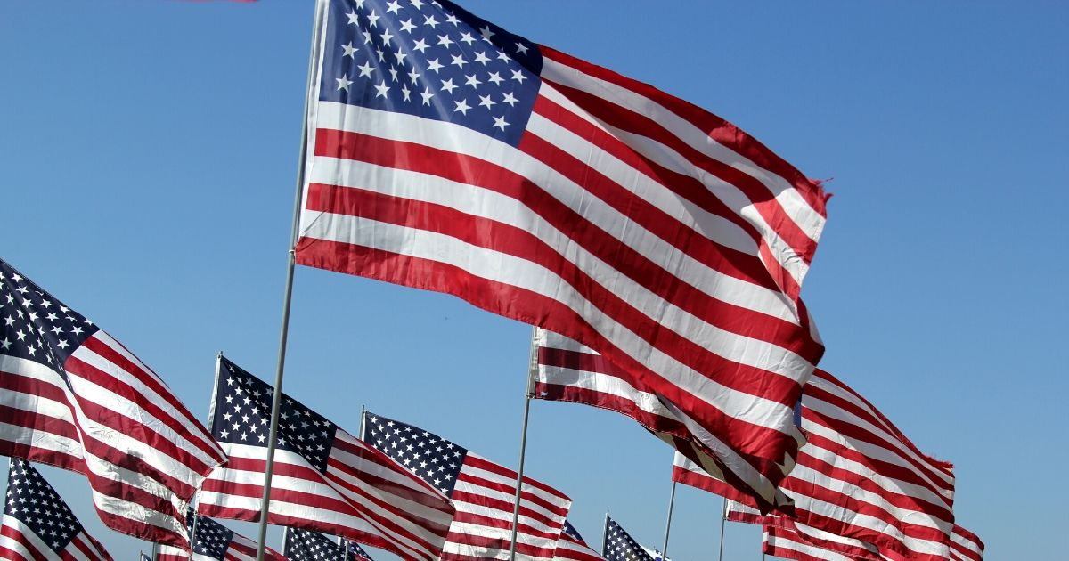 American flags flutter in the wind.