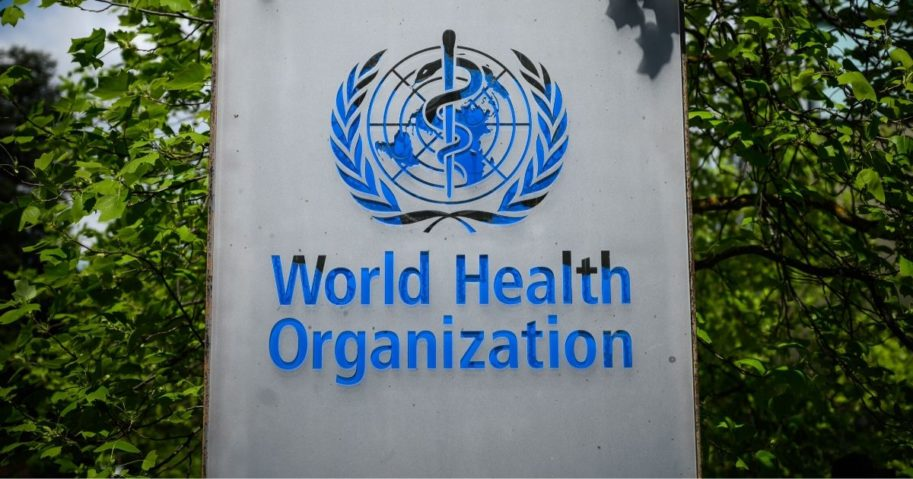 This picture taken on April 24, 2020, shows a sign of the World Health Organization in Geneva next to its headquarters.