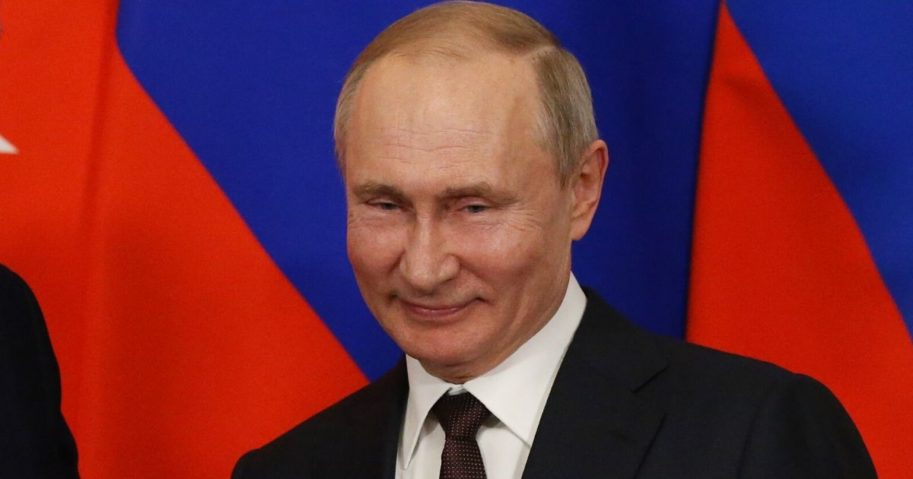 Russian President Vladimir Putin grins in a file photo from March.