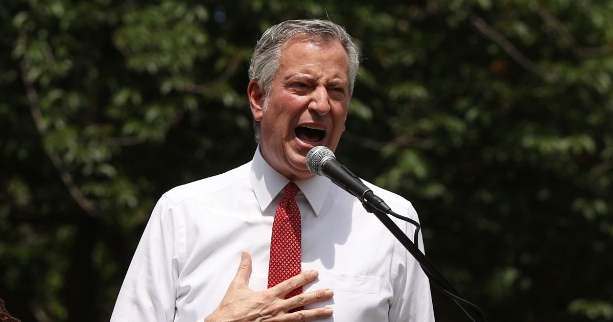 New York Mayor Bill de Blasio speaks to an estimated 10,000 people as they gather in Brooklyn's Cadman Plaza Park for a memorial service for George Floyd on June 4, 2020, in New York City.