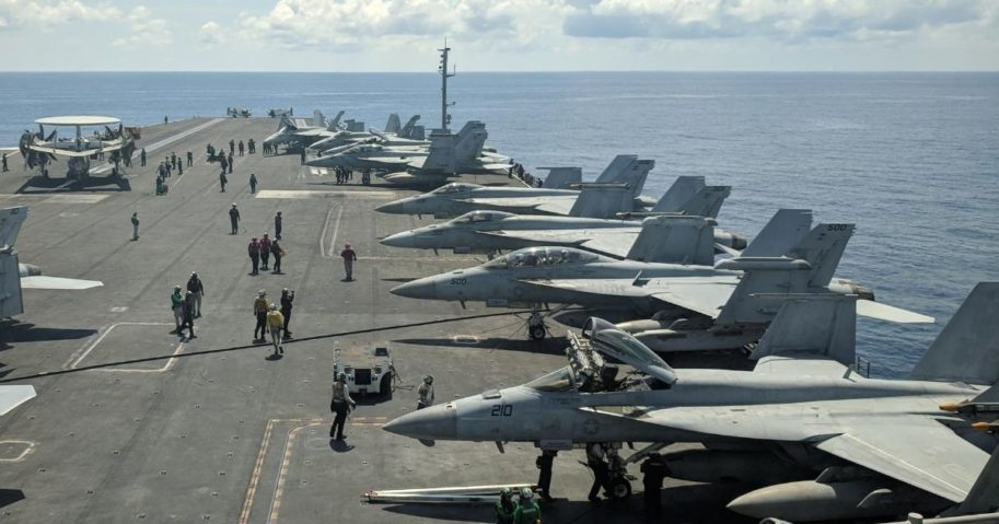 This photograph taken on Oct. 16, 2019, shows U.S. Navy F/A-18 Super Hornet multirole fighters and an EA-18G Growler electronic warfare aircraft on board the USS Ronald Reagan aircraft carrier as it sails in the South China Sea on its way to Singapore.