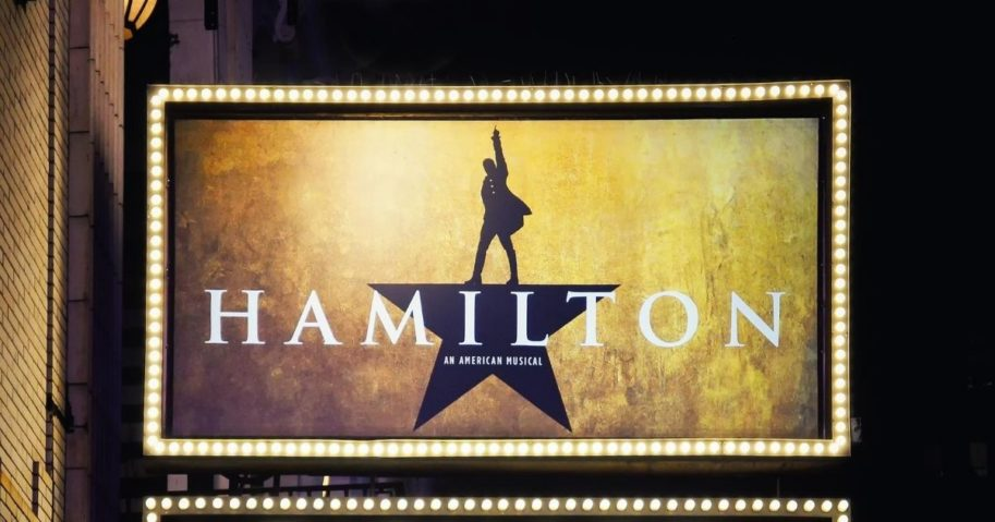 "A sign for the musical ""Hamilton"" in New York City is pictured above."