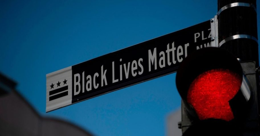 """A new street sign that reads """"Black Lives Matter Plaza NW"""" can be seen at the intersection of H and 16th Street near the White House in Washington, D.C., on June 5, 2020."""
