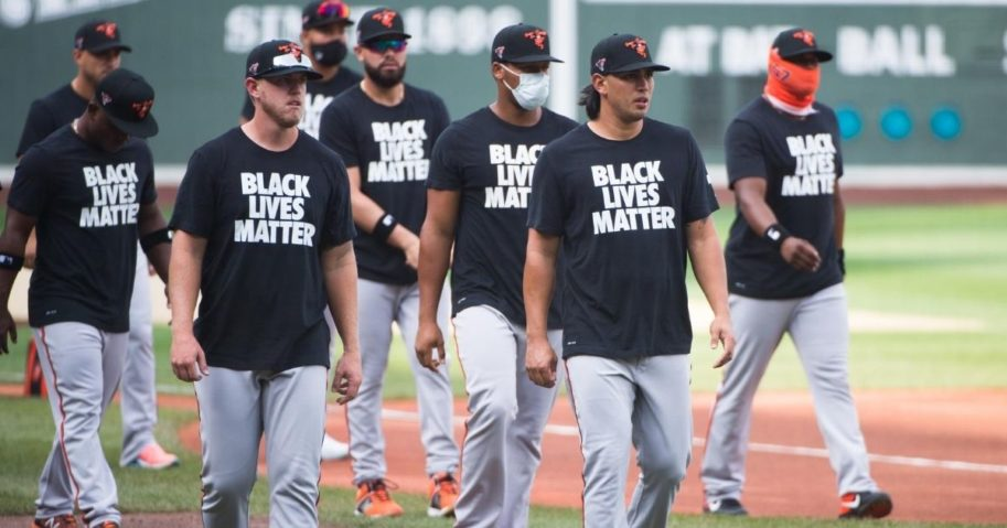 Members of the Baltimore Orioles wear Black Lives Matter T-shirts during batting practice prior to the start of the game against the Boston Red Sox on Opening Day at Fenway Park on July 24, 2020, in Boston.