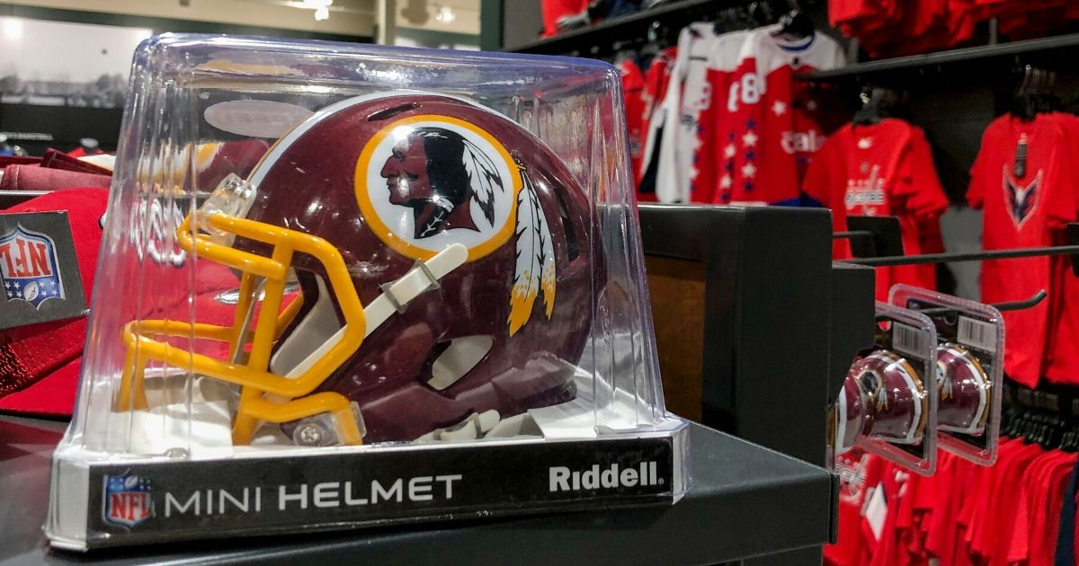A miniature Washington Redskins helmet sits for sale at a sporting goods store in Washington, D.C., on July 7, 2020. The team retired its nickname and logo six days later.