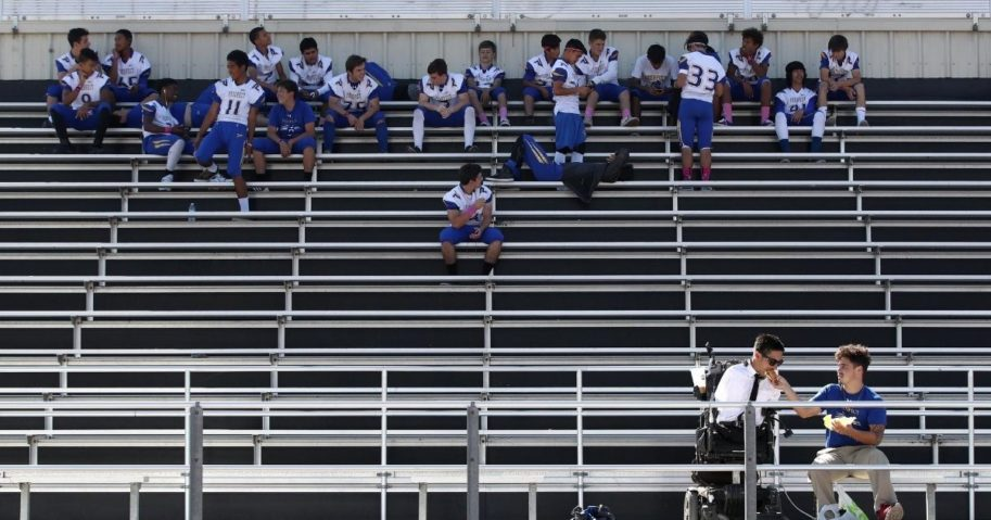High school football players gather in the stands in San Jose, California, on Oct. 19, 2018. A coach in Chattanooga, Tennessee, is urging a return to normalcy amid the COVID-19 pandemic.