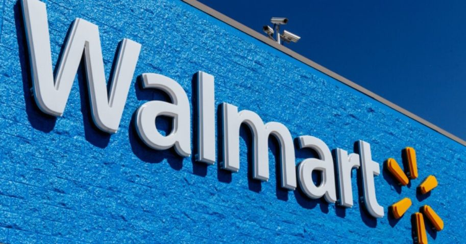 Walmart signage is seen on a store in the image above. Over 100 locations will be offering drive-in movie nights this summer.