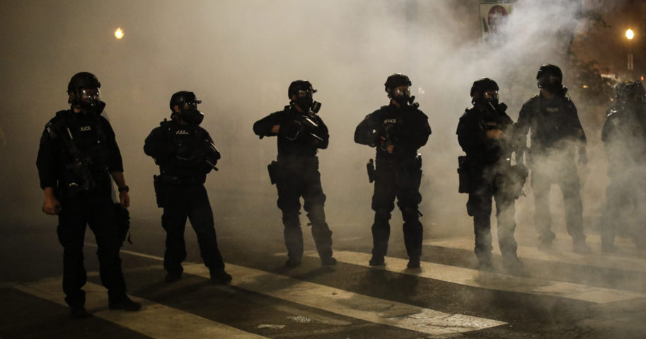Federal officers are surrounded by smoke as they push back rioters during a Black Lives Matter protest at the Mark O. Hatfield United States Courthouse on July 29, 2020, in Portland, Oregon.