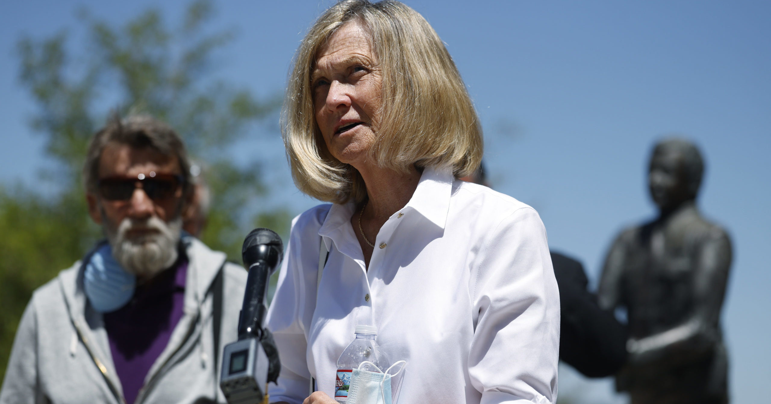 Janet Johnson of Pawcatuck, Connecticut, front, speaks at a press conference after the sentencing hearing on July 1, 2020, for James Curtis Clanton in the death of Helene Pruszynski, Johnson's younger sister, four decades ago in Castle Rock, Colorado. Clanton has been sentenced to life in prison.