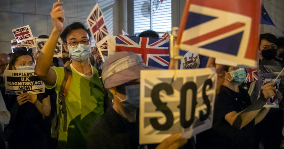 In this Oct. 23, 2019, file photo, demonstrators wave British flags during a rally outside the British Consulate in Hong Kong.