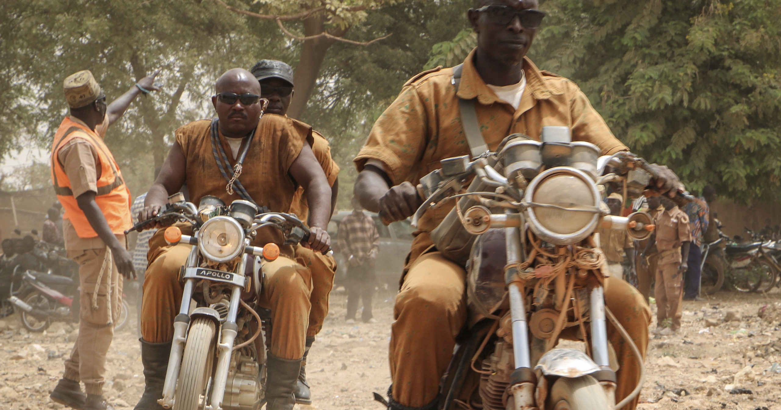 A group of local defense force fighters drive their motorbikes in Ouagadougou, Burkina Faso, on March 14, 2020. In an effort to combat rising jihadist violence, Burkina Faso's military has recruited volunteers to help it fight militants.