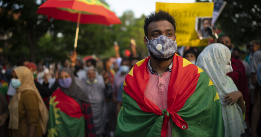 In this July 1, 2020, file photo, protesters outraged by the killing of popular Ethiopian singer Hachalu Hundessa march in St. Paul, Minnesota. Ethiopian officials said on July 8 that at least 239 people have been killed and 3,500 arrested in a week of unrest in Ethiopia.