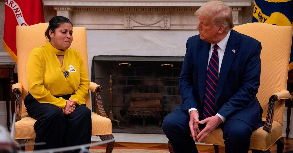 President Donald Trump speaks with Gloria Guillen, the mother of Vanessa Guillen, a Fort Hood soldier found dead after disappearing from Fort Hood, Texas, in the Oval Office of the White House in Washington, D.C., on July 30, 2020.