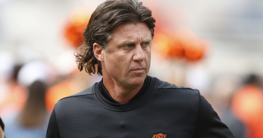 """In this Oct. 6, 2018, file photo, Oklahoma State football coach Mike Gundy runs onto the field before the team's game against Iowa State in Stillwater, Oklahoma. Mike Holder, Oklahoma State's athletic director, said on July 2, 2020, that an internal review had found """"no sign or indication of racism"""" in the football program under Gundy."""