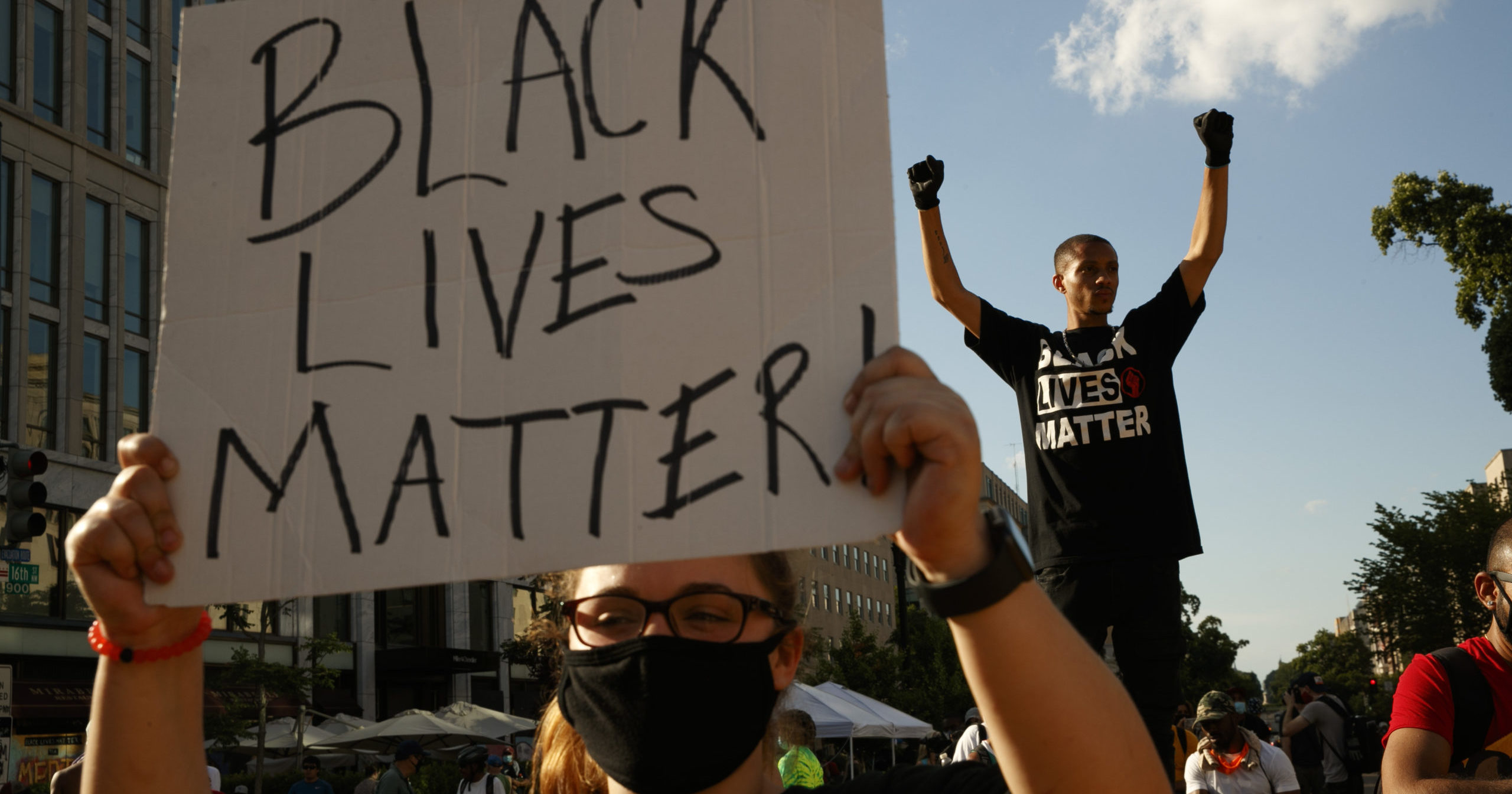 In this June 24, 2020, file photo, demonstrators protest on a section of 16th Street that's been renamed Black Lives Matter Plaza, in Washington.