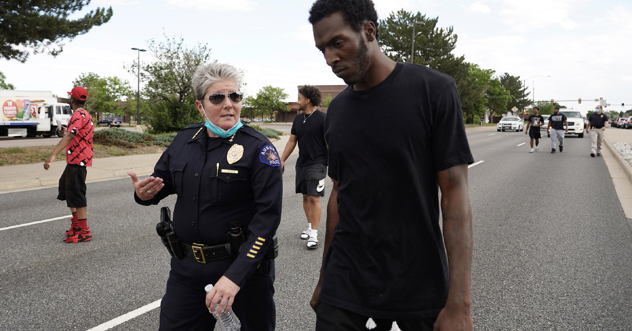 In this June 2, 2020, file photo, interim Aurora Police Chief Vanessa Wilson confers with a demonstrator during a peaceful protest in Aurora, Colorado.