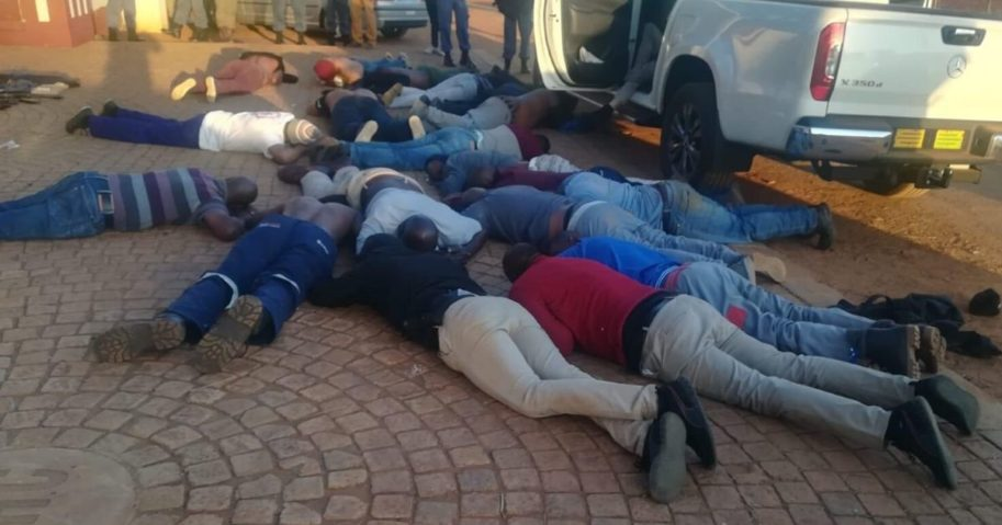 Suspects lie on the ground after a hostage situation unfolded in Johannesburg, South Africa.