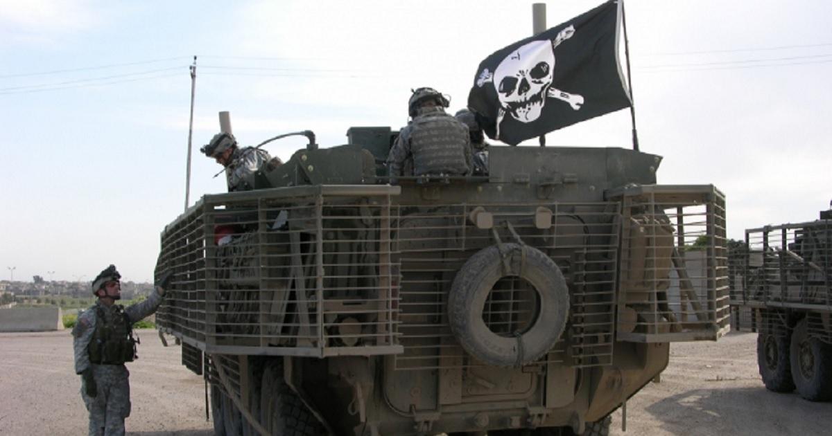 A U.S. ArmyStryker Brigade Combat Team hoists the Jolly Roger in Mosul, Iraq, in 2006.