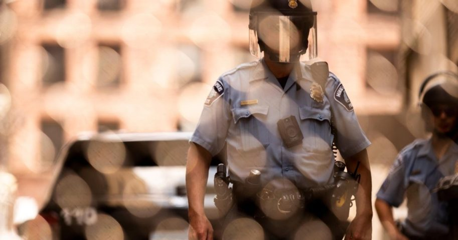 Members of the Minneapolis Police Department are seen through a chain link gate on June 13, 2020, in Minneapolis, Minnesota.