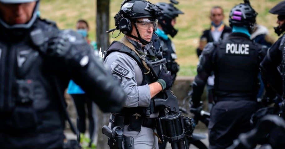 A police officer stands watch in Seattle, Washington, on July 1, 2020.