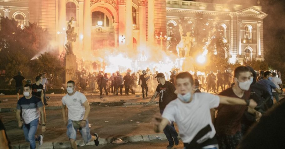 Protesters clash with riot police in Belgrade, Serbia, on July 10, 2020. Hundreds of demonstrators tried to storm Serbia's parliament, clashing with police during the fourth night of protests against the president's new lockdown orders.