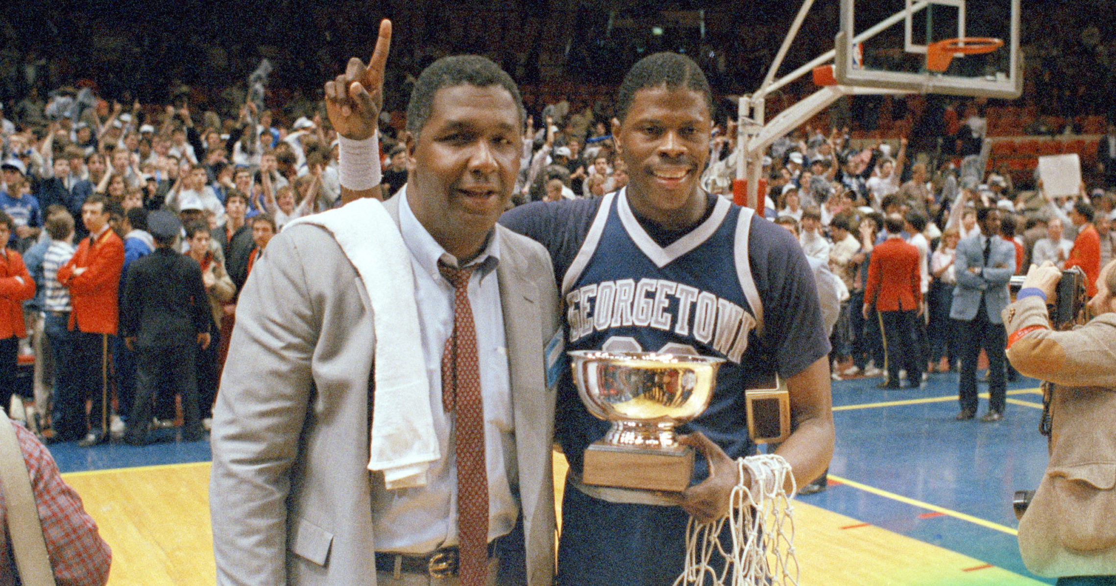 Georgetown head coach John Thompson poses with Patrick Ewing after the Hoyas defeated Houston in the NCAA basketball championship game in Seattle on March 9, 1985.