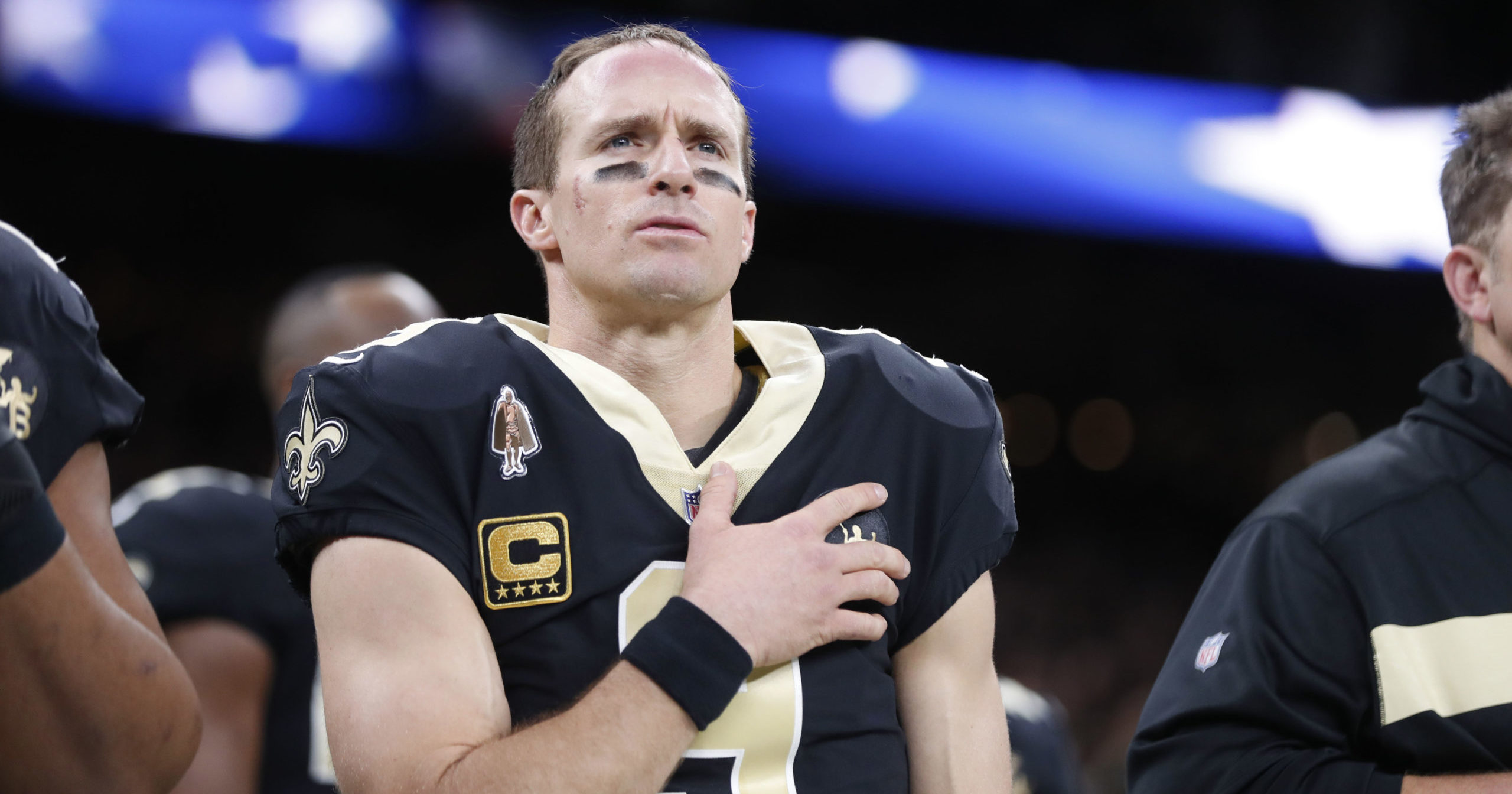 In this Dec. 23, 2018, file photo, New Orleans Saints quarterback Drew Brees holds his hand to his heart during the national anthem before an NFL football game against the Pittsburgh Steelers in New Orleans.