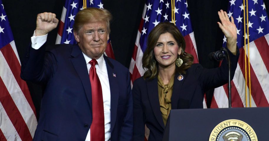 In this Sept. 7, 2018, file photo, President Donald Trump appears with Gov. Kristi Noem in Sioux Falls, South Dakota. Officials said on Aug. 12, 2020, that they plan to erect a security fence around the official governor's residence to protect Noem.