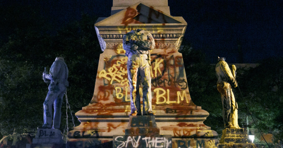 Statues on a Confederate monument are covered in graffiti and beheaded after a protest in Portsmouth, Virginia, on June 10, 2020.