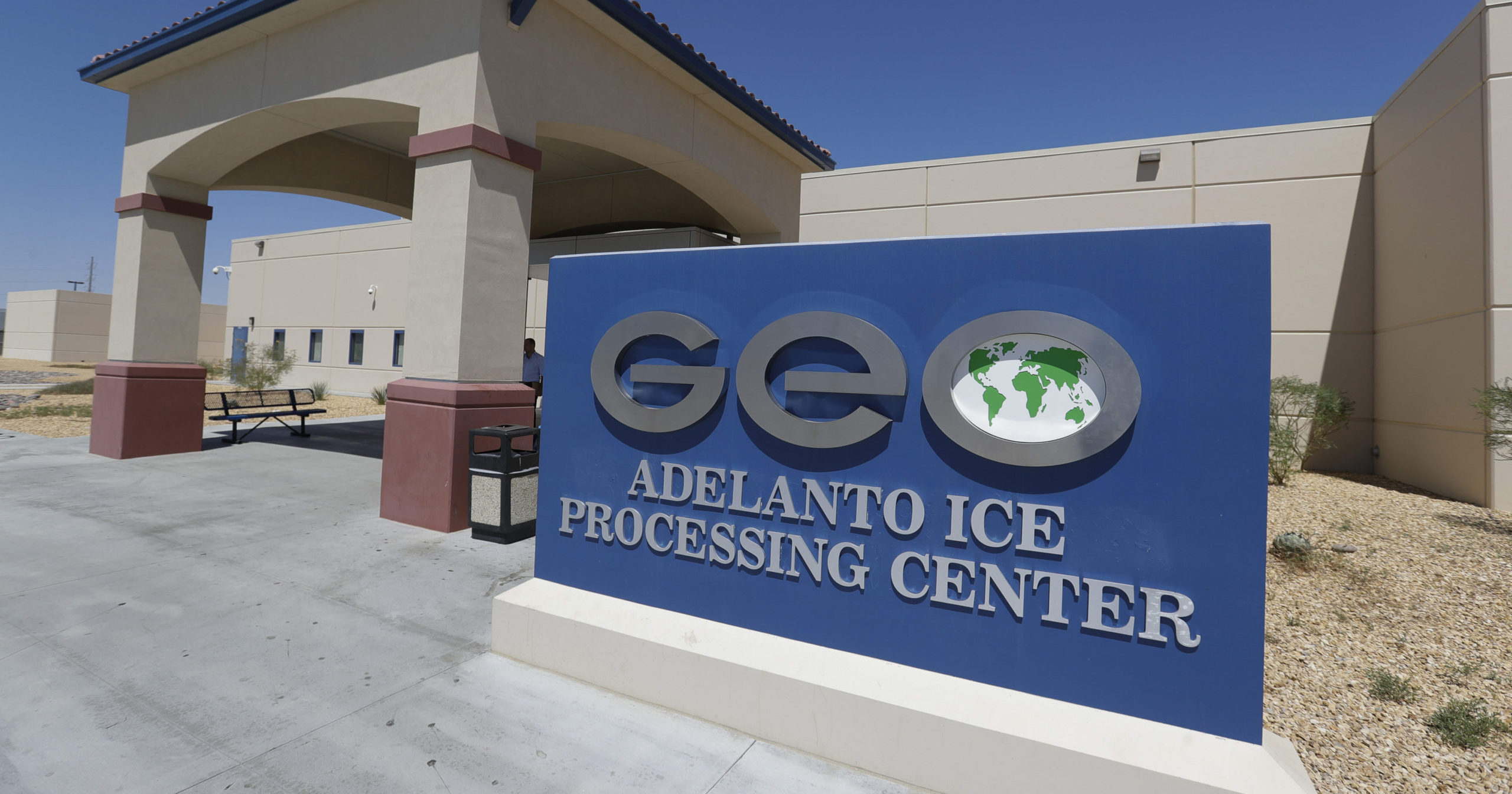 This Aug. 28, 2019, file photo shows the Adelanto US Immigration and Enforcement Processing Center operated by GEO Group, a Florida-based company specializing in privatized corrections, in Adelanto, California.