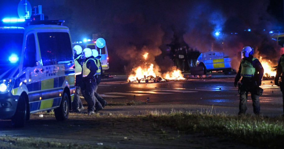 Police are seen as several hundred people riot in Sweden on Aug. 28, 2020. Activists burned a Quran in the southern Swedish city of Malmo, sparking riots and unrest after more than 300 people gathered to protest.