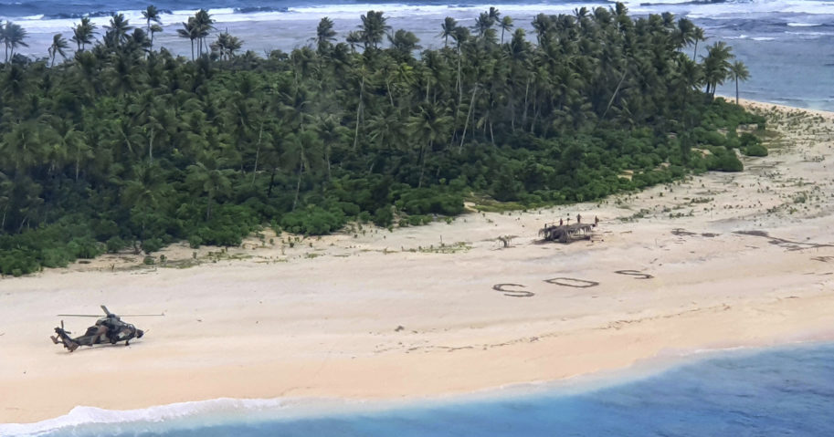 In this photo provided by the Australian Defence Force, an Australian Army helicopter lands on Pikelot Island in the Federated States of Micronesia, where three men were found on Aug. 2, 2020, safe and healthy after missing for three days.