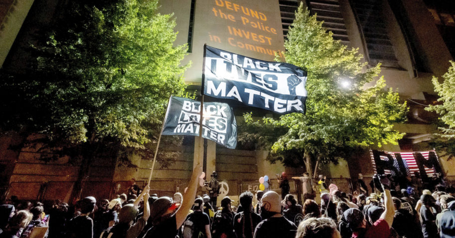 In this July 31, 2020, file photo, Black Lives Matter protesters gather at the Mark O. Hatfield United States Courthouse in Portland, Oregon. At least two federal buildings in Portland have been closed and the FBI is investigating after a threat of violence was reported, officials said on Aug. 21, 2020.