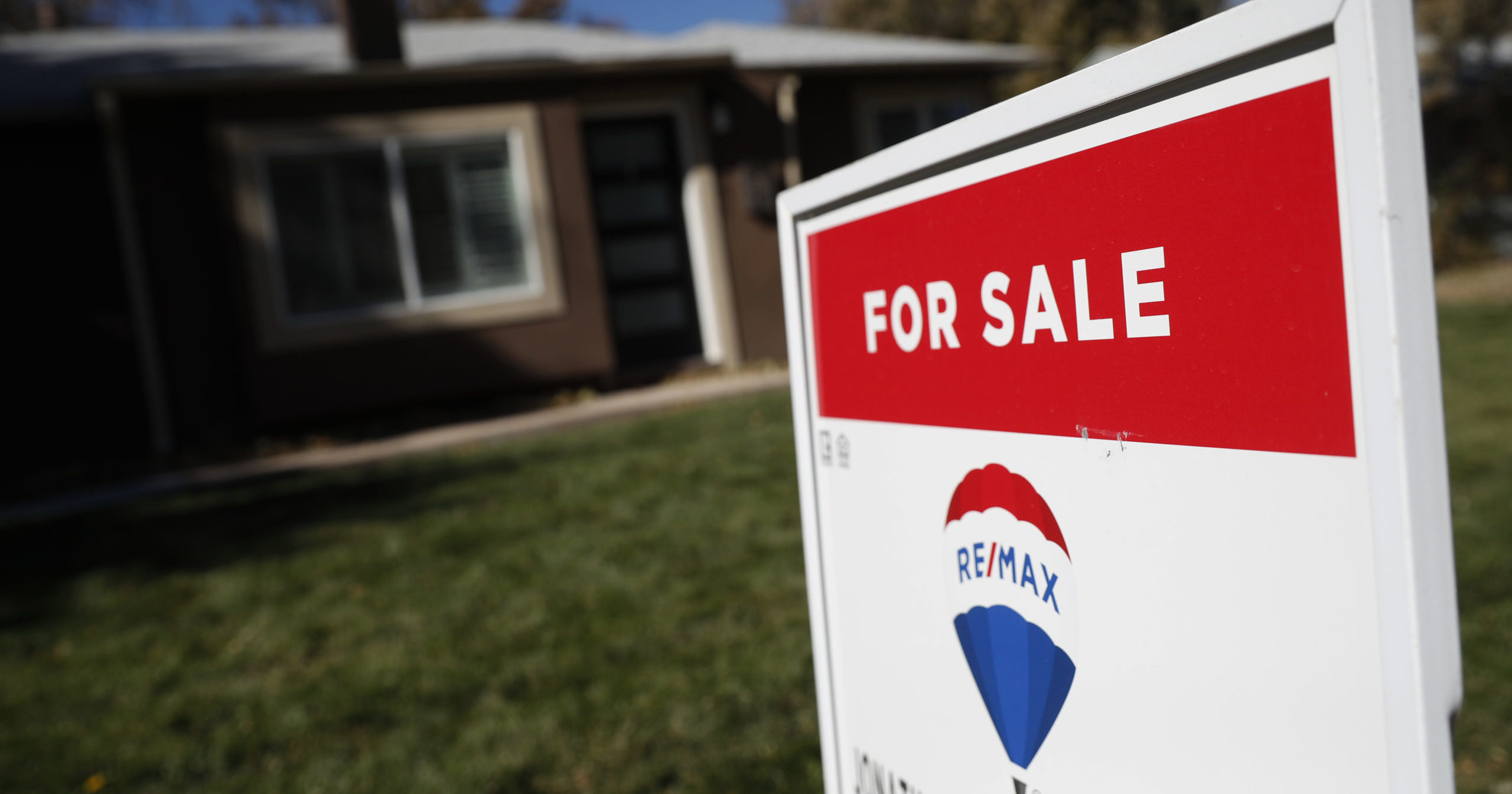 In this Oct. 22, 2019, file photo, a sign stands outside a home for sale in southeast Denver.