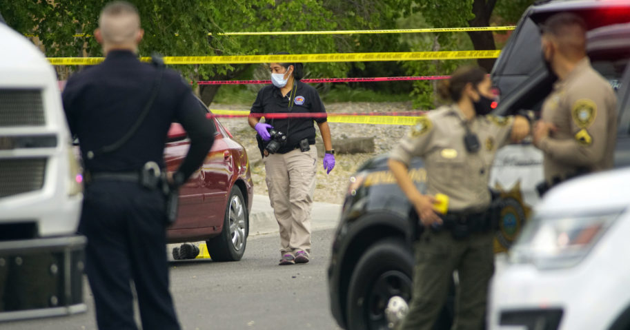 Albuquerque police and Bernalillo County deputies work at the scene of a double shooting on the west side of Albuquerque, New Mexico, the result of a confrontation over a mask on July 21, 2020.