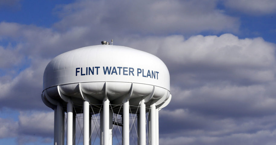 In this March 21, 2016, file photo, the Flint Water Plant water tower is seen in Flint, Michigan. Multiple news outlets reported on Aug. 19, 2020, that the state of Michigan has reached a $600 million agreement to compensate Flint residents whose health was damaged by lead-tainted drinking water.