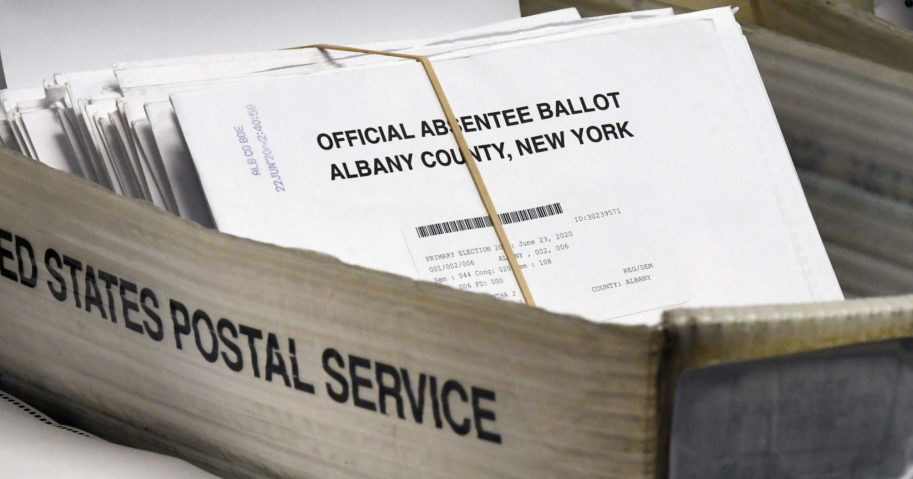 In this June 30, 2020, file photo, absentee ballots wait to be counted at the Albany County Board of Elections in Albany, New York. New York will allow voters to request absentee ballots for the general election because of the coronavirus under a new state law signed by Gov. Andrew Cuomo on Aug. 20.