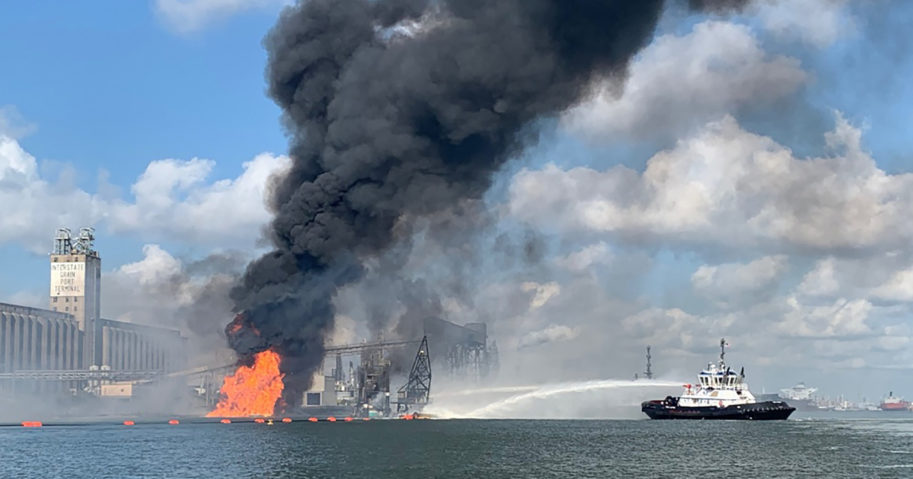 In this photo released by the U.S. Coast Guard, Coast Guard crews respond to a fire in the Port of Corpus Christi on Aug. 21, 2020, in Corpus Christi, Texas.