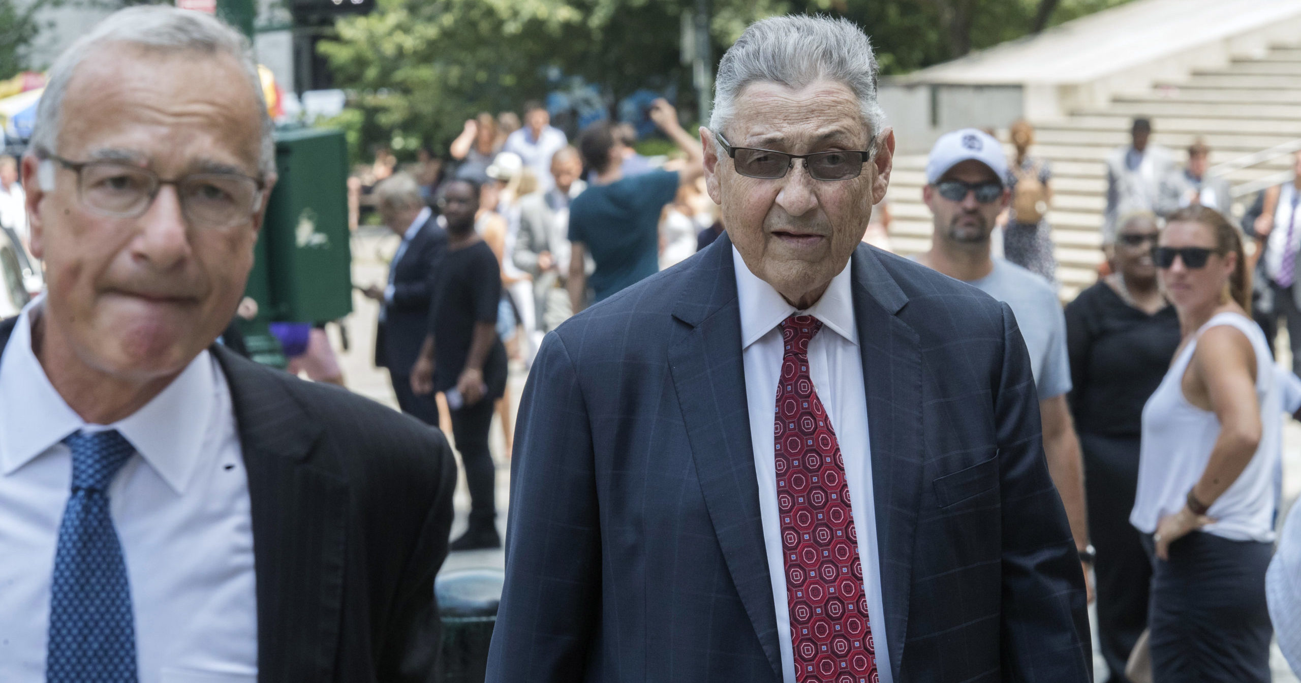 In this July 27, 2018, file photo, former New York Assembly Speaker Sheldon Silver, right, arrives at federal court in New York. Silver has been sentenced to 6 1/2 years in prison on corruption charges.