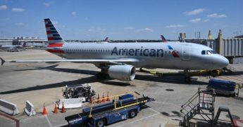 An American Airlines airplane is seen at gate at Washington National Airport on April 11, 2020, in Arlington, Virginia.
