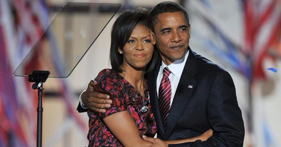 Barack Obama hugs Michelle Obama on stage at the Democratic National Convention 2008 on Aug. 28, 2008.