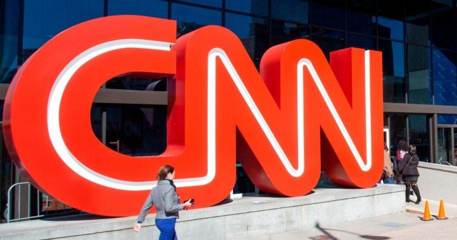 People walk outside CNN Center on Oct. 24, 2018, in Atlanta.