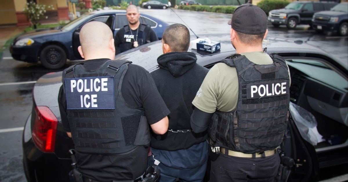 In this Feb. 7, 2017, file photo released by U.S. Immigration and Customs Enforcement, foreign nationals are arrested during a targeted enforcement operation conducted by ICE aimed at immigration fugitives, re-entrants and at-large criminal aliens in Los Angeles.