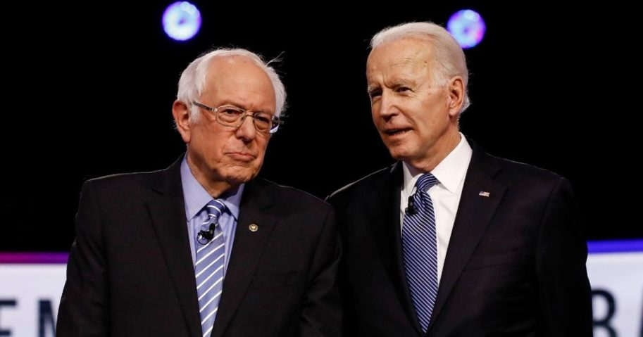 In this Feb. 25, 2020, file photo, Vermont independent Sen. Bernie Sanders, left, and former Vice President Joe Biden talk before a Democratic presidential primary debate in Charleston, South Carolina.