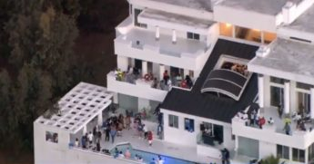 Partygoers are seen at a Beverly Crest mansion.