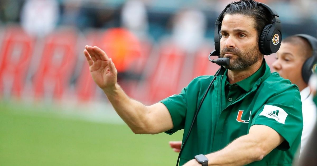 In this Nov. 9, 2019, file photo, Miami head coach Manny Diaz calls out a play during the first half of an NCAA college football game against Louisville in Miami Gardens, Florida.