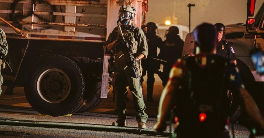 A policeman in a gas mask stands guard on July 25, 2020, in Richmond, Virginia.