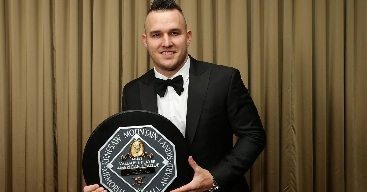 AL MVP Mike Trout of the Los Angeles Angels poses for a photo with the trophy at the 97th annual New York Baseball Writers' Dinner at the Sheraton New York on Jan. 25, 2020.