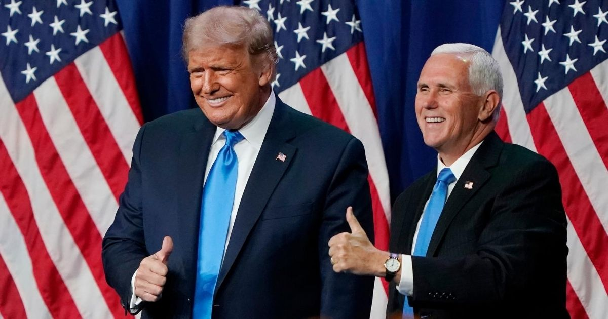 President Donald Trump and Vice President Mike Pence give a thumbs up on the first day of the Republican National Convention at the Charlotte Convention Center in North Carolina on Aug. 24, 2020.