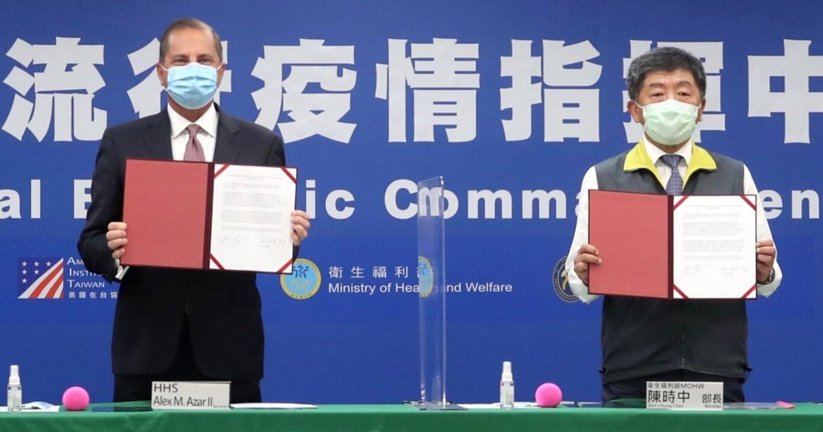 U.S. Health and Human Services Secretary Alex Azar, left, and Taiwan Health Minister Chen Shih-chung display documents of health cooperation during a signing ceremony in Taipei on Aug. 10, 2020.
